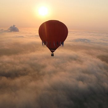 Hot air balloon above the clouds